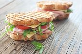 stock photo of deli  - Grilled deli sandwiches with ham and cheese - JPG