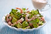 stock photo of shrimp  - Fresh green salad with shrimp and avocado - JPG