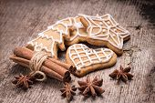 pic of christmas spices  - Christmas iced gingerbread cookies with various spices on wood background - JPG