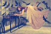 stock photo of floating  - Floating Levitation shot of a Woman and Her Black Birds - JPG