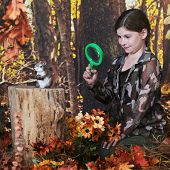 foto of chipmunks  - An attractive elementary girl viewing  a chipmunk through her magnifying glass - JPG