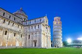 stock photo of piazza  - Piazza del Duomo with Pisa tower and the Cathedral illuminated at night Pisa Italy - JPG