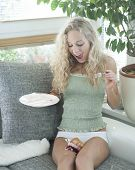 foto of fallen  - Young woman looking at fallen cake on legs in house - JPG