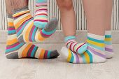 pic of stocking-foot  - feet of a beautiful family with striped socks