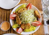 stock photo of alfalfa  - A beansprout salad with alfalfa bean sprouts tomato croutons pepper chick peas and green vegetables shot from the top. 