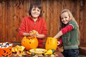 stock photo of jack-o-lantern  - Kids carving their pumpkin jack - JPG