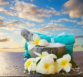 stock photo of frangipani  - Spa and wellness setting with frangipani  flowers and towels - JPG