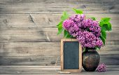 picture of vase flowers  - lilac flowers in vase on wooden background - JPG