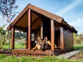 picture of alsatian  - German shepherd resting in its wooden kennel - JPG