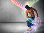 foto of break-dance  - Athletic trendy shirtless young man in a hat doing a break dance routine surrounded by colorful light streaks - JPG