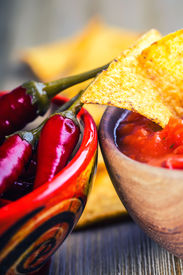 stock photo of doritos  - Salsa with tortilla chips and chilli peppers - JPG