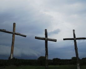 picture of christian cross  - three wooden crosses against a stormy sky - JPG