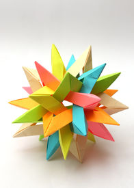 stock photo of tetrahedron  - Colorful modular origami paper star isolated on white - JPG