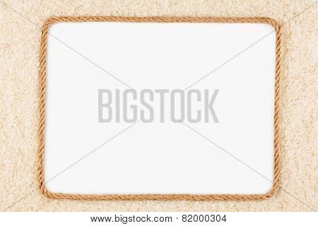 Frame Made Of Rope With Rice Lying On A White Background