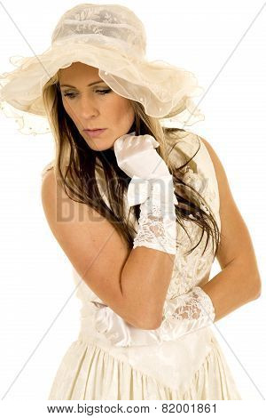 Woman In A White Dress And Hat And Gloves Hand Under Chin Look Down