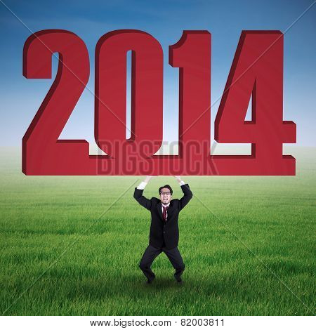 Businessman Is Lifting New Year 2014