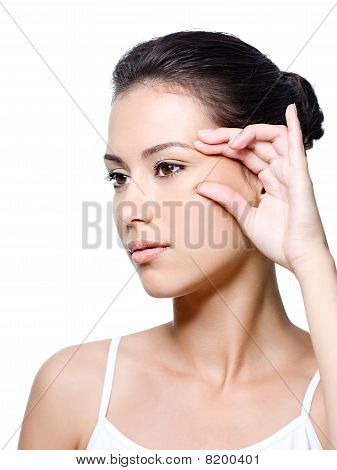 Woman Pinching Skin Near Her Eye