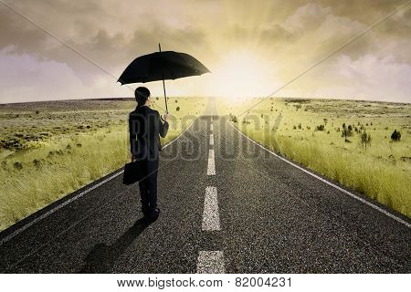 Businesswoman Standing On The Highway Road