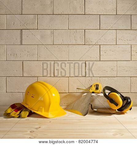 Brick Background, Helmet And Trowel