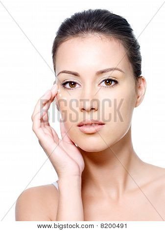 Woman's Face With Points Of Cream Under The Eye