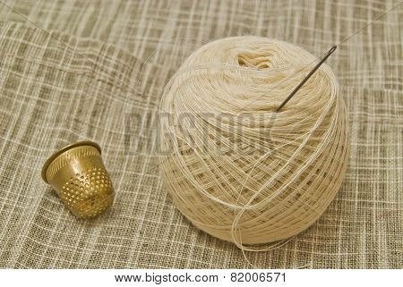 White Yarn With Needle And Thimble