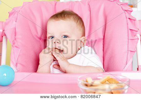 Cute Baby Eating Biscuit