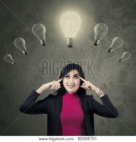 Lovely Female Entrepreneur With Lamps