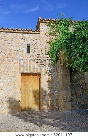 Drystone Building With Wooden Door