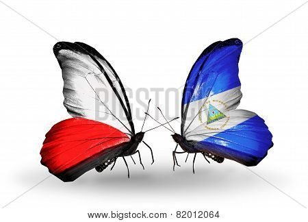 Two Butterflies With Flags On Wings As Symbol Of Relations Poland And Nicaragua