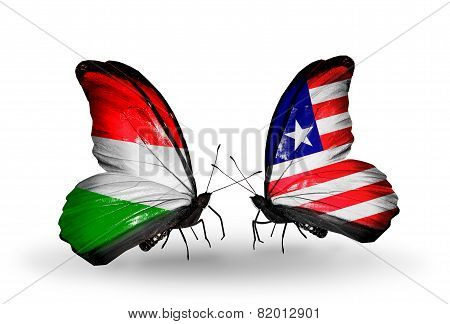 Two Butterflies With Flags On Wings As Symbol Of Relations Hungary And Liberia