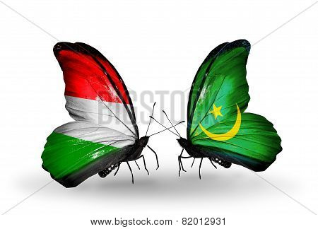 Two Butterflies With Flags On Wings As Symbol Of Relations Hungary And Mauritania