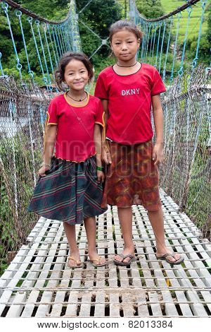 Little Nepalese Girls On Rope Hunging Suspension Bridge