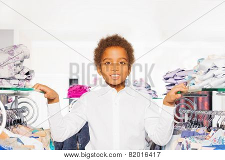Close-up view of African boy in clothes store