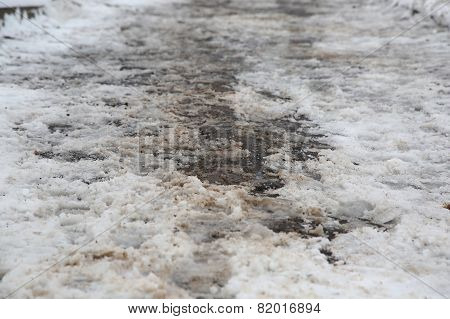 The Sidewalk After Snowall And Dirty Snow