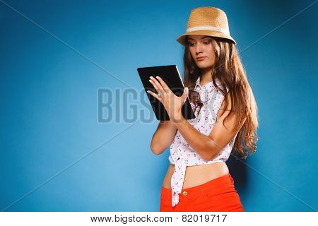 Girl Using Tablet Computer E-book Reader.