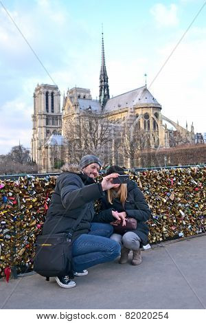 Paris - Dec 30: Tourists Making Photo Near The Notre-dame Cathedral (aka Cathedral Notre Dame De Par