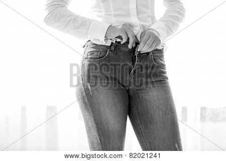 Monochrome Closeup Photo Of Sexy Slim Woman Unbuttoning Her Jeans