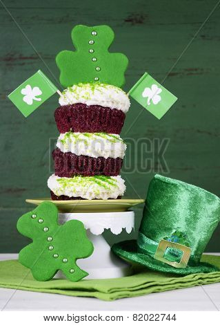 Happy St Patricks Day Triple Layer Cupcake With Shamrock Decorations And Leprechaun Hat Against A Vi
