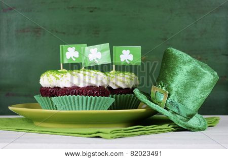 Happy St Patricks Day Cupcakes With Green Theme Decorations On Vintage Style Green Wood Background.