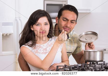 attractive couple cooking together unpleasant meal
