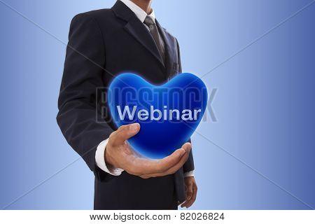 Businessman with webinar word
