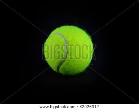 Single Tennis Ball On Black Background