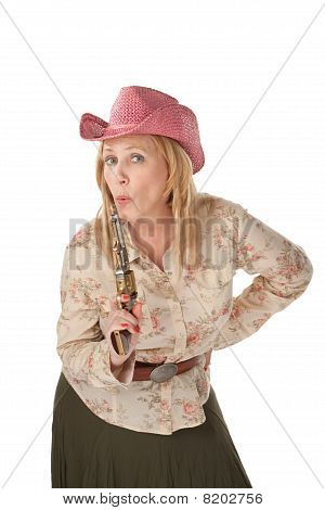 Cowgirl on White Background with A Recently Used Pistol