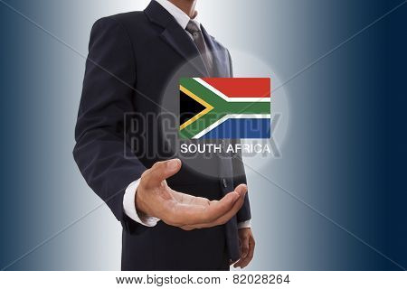 Businessman hand showing South Africa Flag