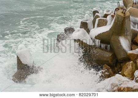 Breakwater Covered By Ice