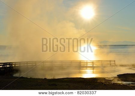 Sunrise And Steaming Geyser In West Thumb Area In Yellowstone National Park, Wyoming