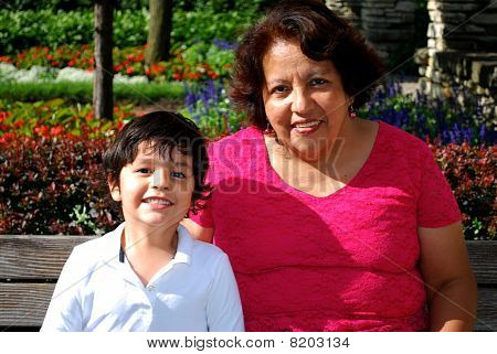 Hispanic Grandmother reading with her grandson
