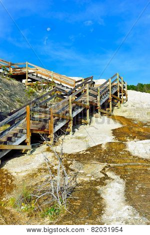 Wooden Walkway And A Moon In The Sky In Minerva Terrace, Mammoth Hot Springs Area Of Yellowstone Nat