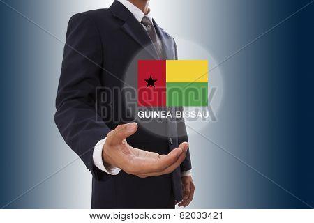 Businessman hand showing Guinea Bissau Flag