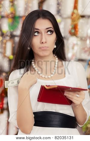 Cute Broke Woman at  Shopping Checking Wallet